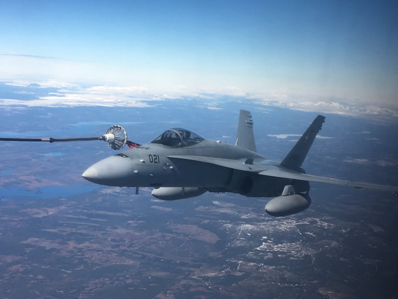A Swiss F/A 18 refuelled for the first time by a Swedish C-130 tanker